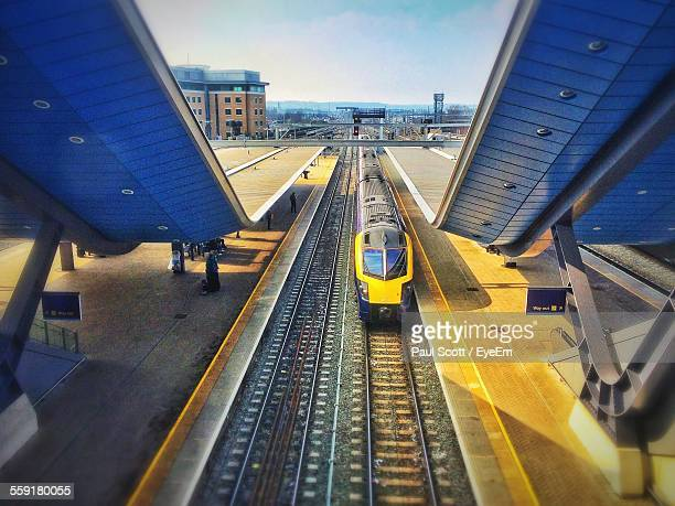 high angle view of train on railroad station - train stock photos and pictures