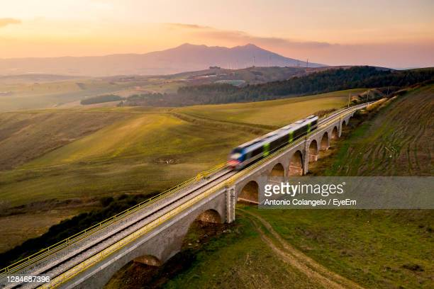 high angle view of train on rrailway against sky at the sunset - treno foto e immagini stock