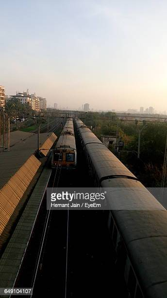 High Angle View Of Trains At Railroad Station Platform Against Clear Sky