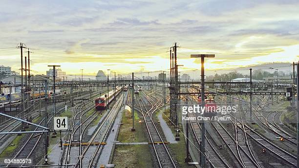 High Angle View Of Trains On Railroad Tracks At Sunset