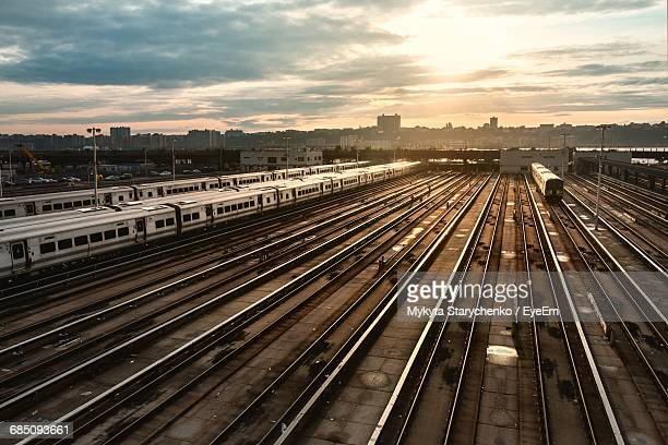 High Angle View Of Trains On Track Against Sky During Sunset