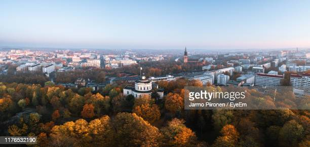 high angle view of trees and buildings against sky during autumn - トゥルク ストックフォトと画像