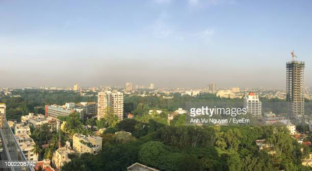 high angle view of trees and buildings against sky - bangalore city stock pictures, royalty-free photos & images