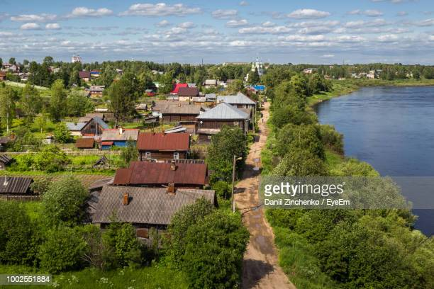 high angle view of trees and buildings against sky - zinchenko stock pictures, royalty-free photos & images