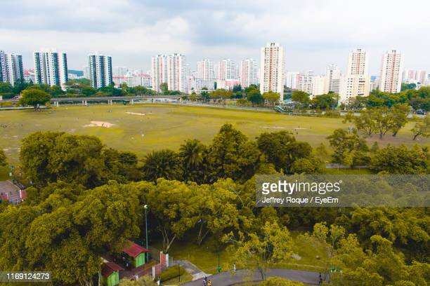 high angle view of trees and buildings against sky - jeffrey roque stock photos and pictures