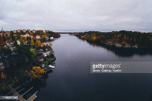 high angle view of trees and buildings against sky - colbing stock pictures, royalty-free photos & images