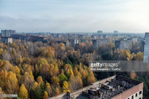 high angle view of trees and buildings against sky - chernobyl stock pictures, royalty-free photos & images