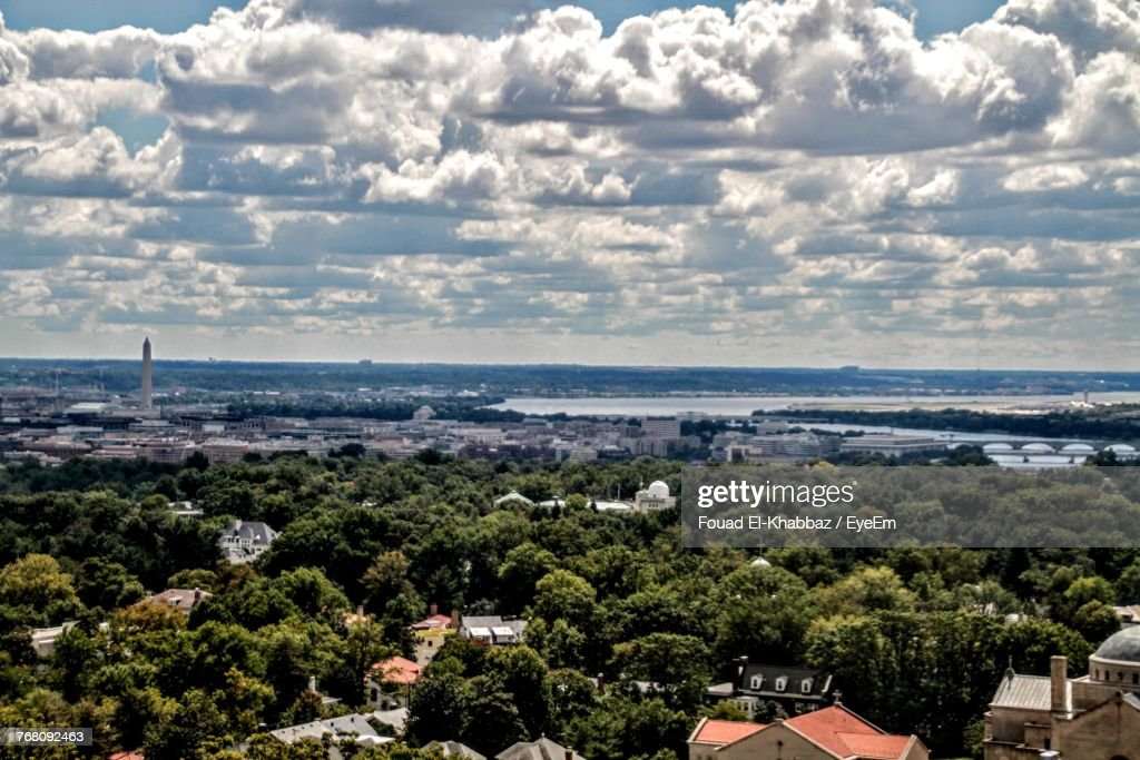 High Angle View Of Trees And Cityscape Against Sky : Stock Photo