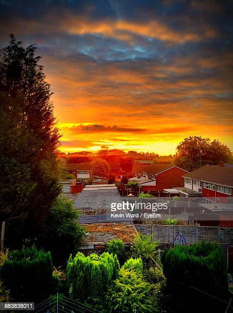 High Angle View Of Trees And Houses Against Orange Sky