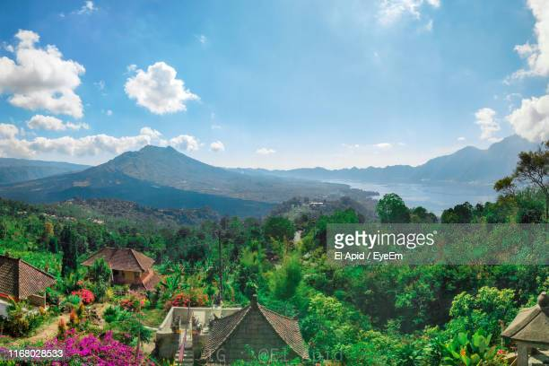 high angle view of trees and houses against sky - kintamani district stock pictures, royalty-free photos & images