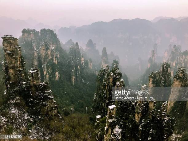 high angle view of trees and mountains against sky - pandora peaks stock photos and pictures