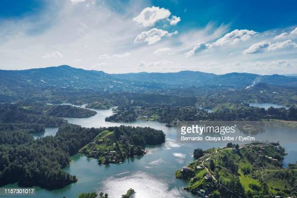 high angle view of trees and mountains against sky - guatapé stock pictures, royalty-free photos & images