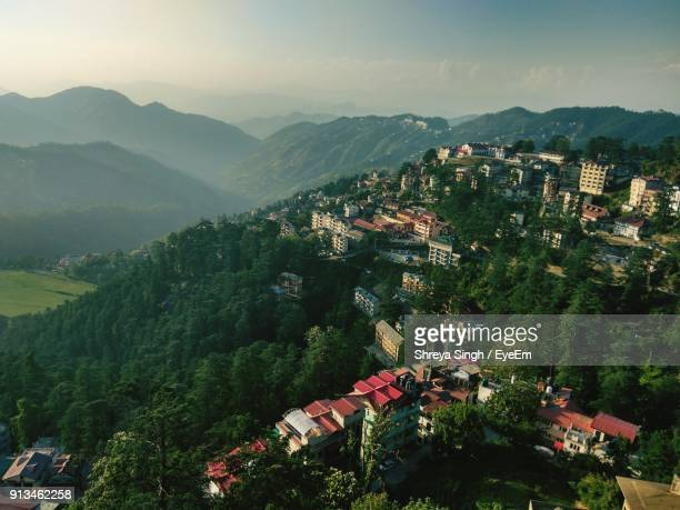 high angle view of trees and mountains against sky - shimla stock pictures, royalty-free photos & images