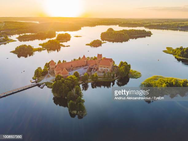 high angle view of trees by lake against sky during sunset - lithuania stock pictures, royalty-free photos & images