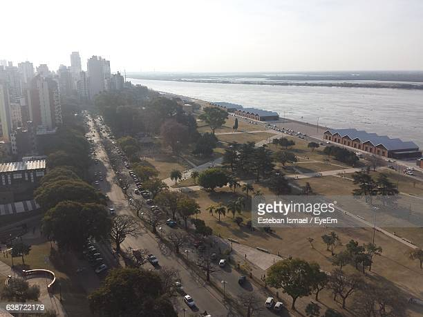 High Angle View Of Trees In City By Sea