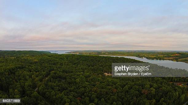 high angle view of trees on landscape against cloudy sky - peterborough ontario stock photos and pictures