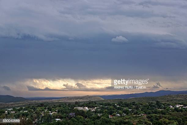 high angle view of trees on landscape against sky - andres ruffo stock pictures, royalty-free photos & images