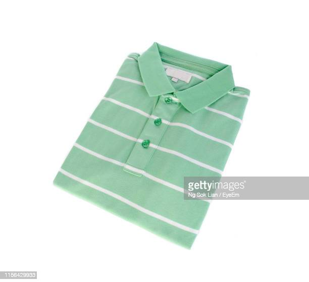 high angle view of t-shirt on white background - all shirts photos et images de collection