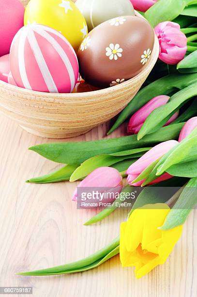 High Angle View Of Tulips With Easter Eggs On Table