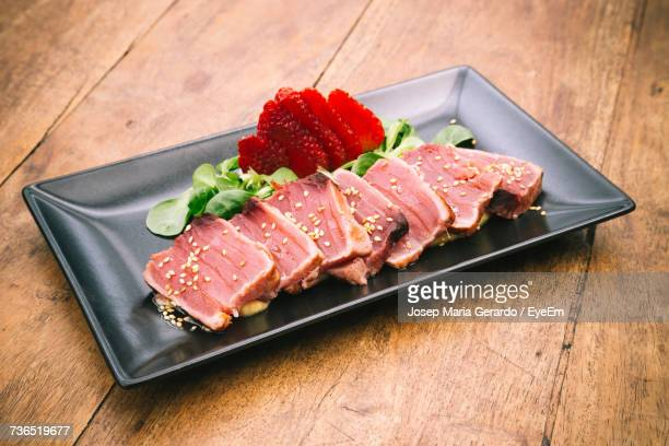 High Angle View Of Tuna Tataki Served In Plate On Table