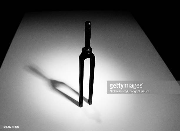 High Angle View Of Tuning Fork On Table