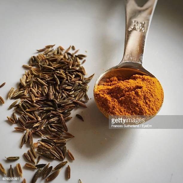 High Angle View Of Turmeric And Cumin On Table