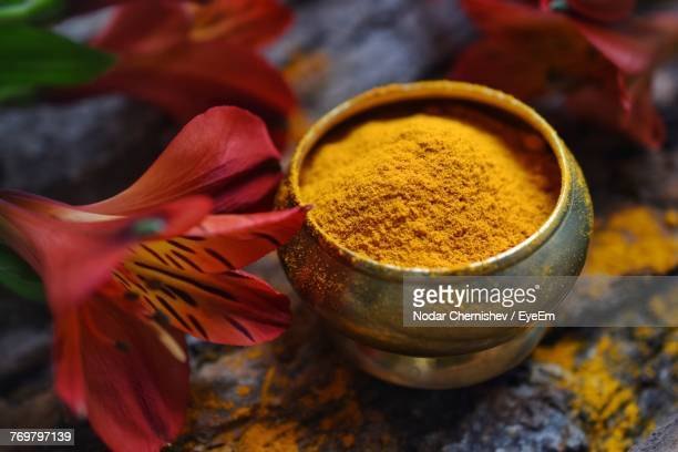 High Angle View Of Turmeric And Flowers