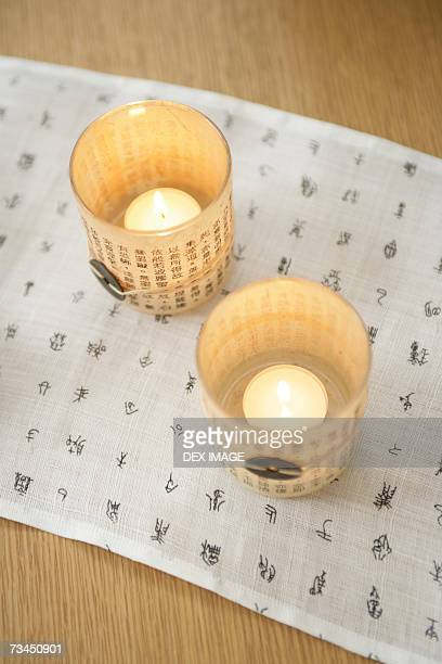 High angle view of two candles on a place mat