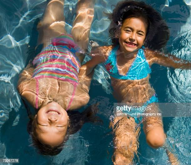 high angle view of two girls in swimming pool - japanese girls hot stock photos and pictures