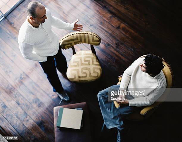 high angle view of two men talking indoors