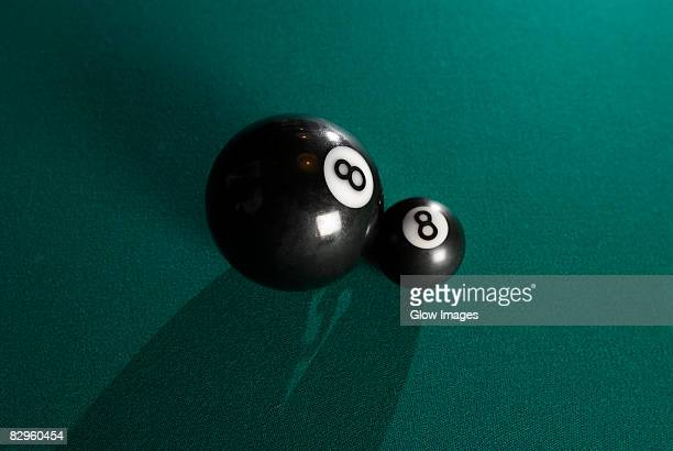 High angle view of two pool eight balls on a pool table