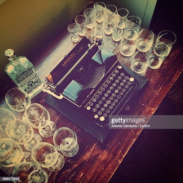 High Angle View Of Typewriter And Glasses On Table