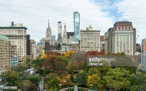 high angle view of union square park in autumn - new york - madison avenue stock pictures, royalty-free photos & images