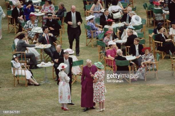 High angle view of unspecified guests attending the garden party, hosted by Queen Elizabeth II and Prince Philip, Duke of Edinburgh, at Buckingham...