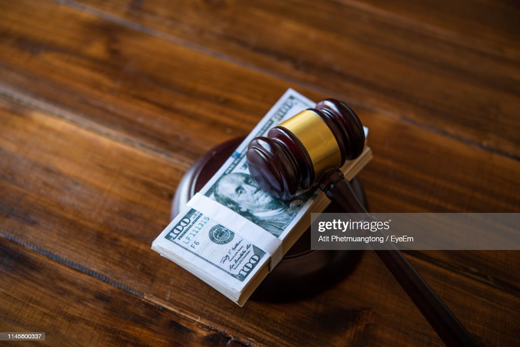 High Angle View Of Us Paper Currency And Gavel On Table : Stock-Foto