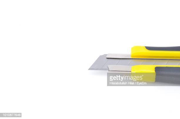 high angle view of utility knife over white background - utility knife stock photos and pictures