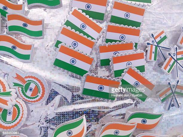 high angle view of various badges with indian flag on table - indian flag stock pictures, royalty-free photos & images