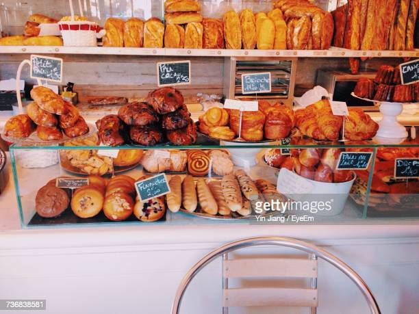 High Angle View Of Various Baked Pastry Items In Display Cabinet At Bakery