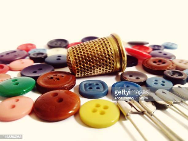 high angle view of various buttons and other sew equipments - embroidery stock pictures, royalty-free photos & images