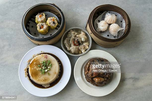 High Angle View Of Various Chinese Dishes On Marble