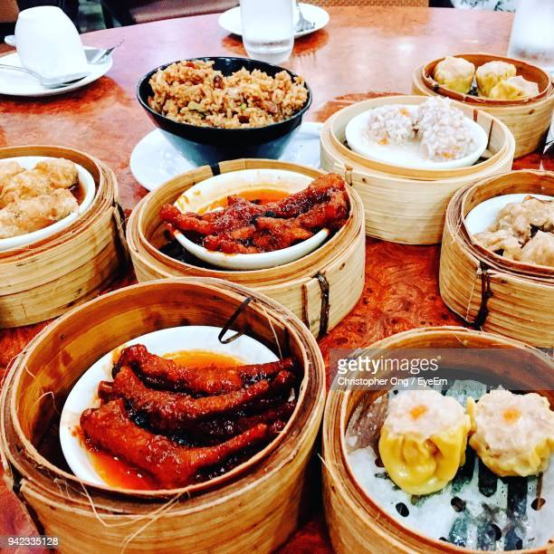 High Angle View Of Various Chinese Food Served On Table