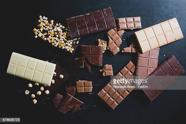high angle view of various chocolate bars on table - chocolate bar stock photos and pictures