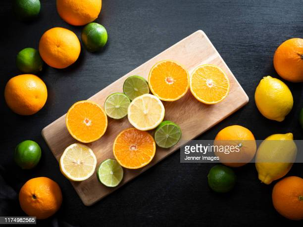 high angle view of various citrus fruits. - copy space stock pictures, royalty-free photos & images