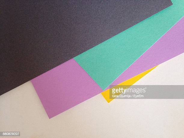 High Angle View Of Various Construction Papers On Table