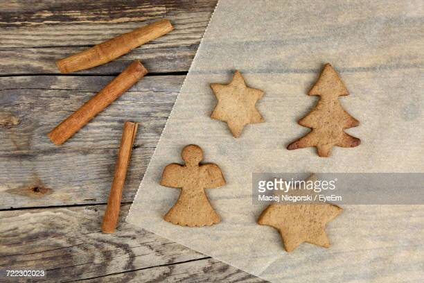 High Angle View Of Various Cookies With Cinnamon On Wooden Table