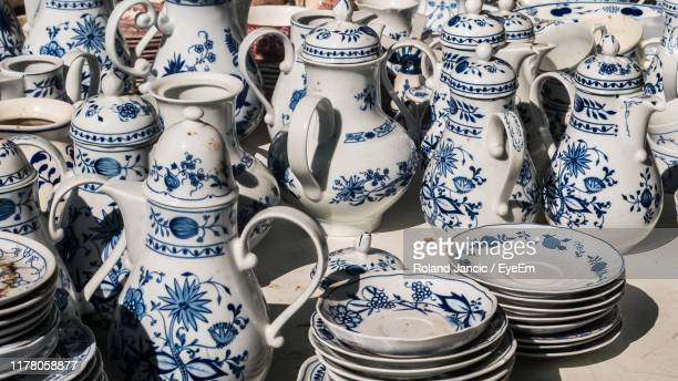 high angle view of various crockery for sale at market - collection photos et images de collection