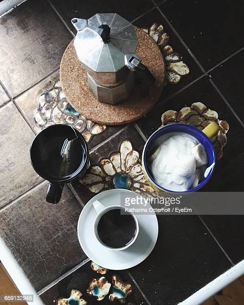 High Angle View Of Various Drinks And Moka Pot On Floor