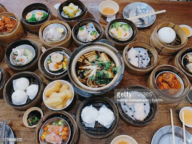 high angle view of various food on table - hat yai foto e immagini stock