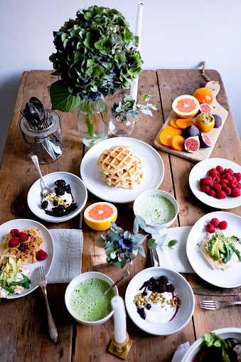High angle view of various food on wooden table by wall - gettyimageskorea