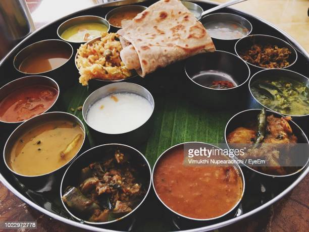 high angle view of various food served on table - colombo stock pictures, royalty-free photos & images